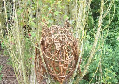 Woven willow owl in a tree at Willows Nursery